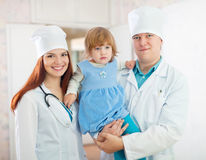 Doctors with baby girl in the clinic Stock Photography