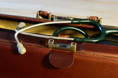 Doctors bag with stethoscope. Brown leather doctors bag with stethoscope Stock Image