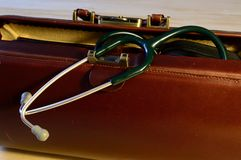 Doctors bag with stethoscope. Brown leather doctors bag with stethoscope Stock Photo