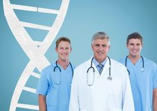 Doctors with a ball with DNA strand. Digital composite of Doctors with a ball with DNA strand royalty free stock images