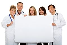 Doctors with a banner Royalty Free Stock Image