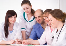 Doctors behind work Royalty Free Stock Photo