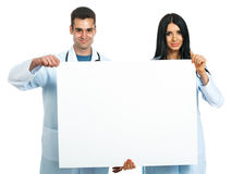 Doctors with a board Royalty Free Stock Image