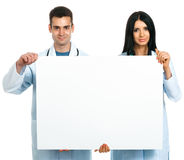 Doctors with a board Royalty Free Stock Photography