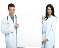 Doctors with a board Stock Photos