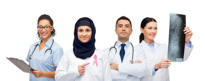 Doctors with breast cancer awareness ribbon Royalty Free Stock Images