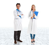 Doctors in a bright room Royalty Free Stock Images