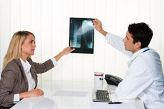 Doctors call. Patient and doctor in discussion. Doctors call. Patient and doctor talking to a doctor's office Royalty Free Stock Photos