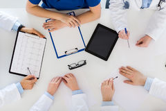 Doctors with cardiogram and tablet pc at hospital Stock Photos