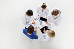 Doctors with cardiogram and and tablet pc Royalty Free Stock Images