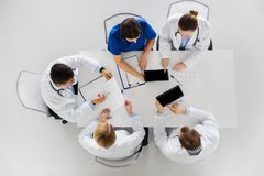 Doctors with cardiograms and tablet pc at hospital Royalty Free Stock Photos