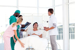 Doctors caring to a patient Stock Images