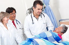Doctors checking on a patient Stock Image