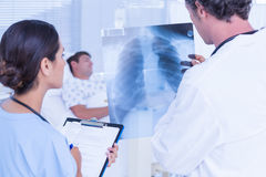 Doctors checking patients xray Stock Photos