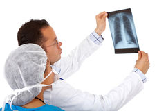 Doctors checking an x-ray Stock Images