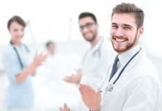 Doctors clapping hands and applauding on consent. Concept of success royalty free stock image