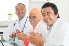 Doctors clapping hands Royalty Free Stock Image