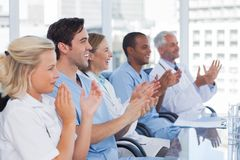 Doctors clapping their hands Stock Photos
