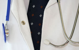 Doctors coat. Showing tie shirt and stethoscope stock images