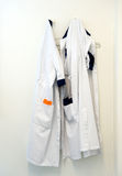 Doctors coats Stock Images