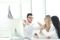 Doctors colleagues discuss the x-ray of the patient royalty free stock photos