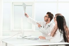 Doctors colleagues discuss the x-ray of the patient stock photos