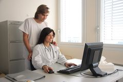 Doctors at computer Stock Photo