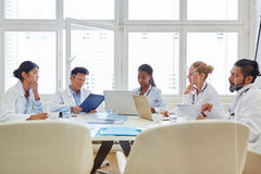 Doctors in computer training. Learn together in workshop royalty free stock image
