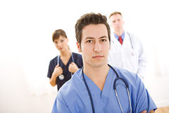 Doctors: Concerned Medical Intern with Others Royalty Free Stock Photography