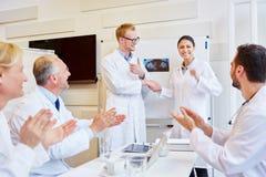 Doctors congratulate colleague. For successful presentation stock images