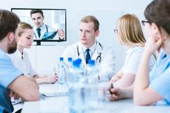 Doctors consulting case Stock Photo