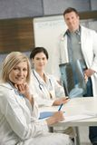 Doctors consulting about x-ray image Royalty Free Stock Images