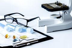 Doctors desk with microscope and test tubes.  Royalty Free Stock Photo