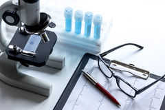 Doctors desk with microscope and test tubes Royalty Free Stock Photo