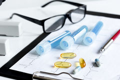 Doctors desk with microscope and test tubes Royalty Free Stock Image