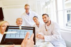 Doctors discussing ECG finding. In meeting and thinking about diagnostic for patient stock photos