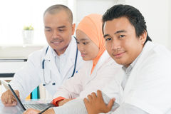 Doctors discussing at hospital office. Stock Image
