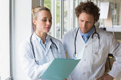 Doctors discussing over file Stock Photography