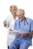 Doctors discussing patient's notes Royalty Free Stock Photo