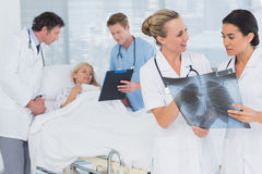 Doctors discussing about patients file Stock Photo