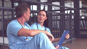 Doctors discussing the report on clipboard stock footage