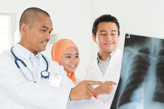 Doctors discussing on x-ray scan Stock Photo