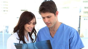 Doctors discussing about a Xray. In a clinic stock footage