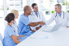 Doctors doing hands shakes Royalty Free Stock Images