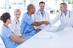 Doctors doing hands shakes Stock Images