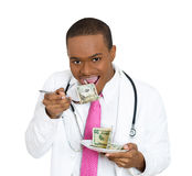 Doctors eating money Stock Photos