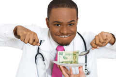 Doctors eating money Royalty Free Stock Images