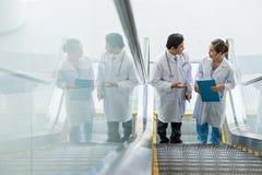 Doctors on escalator Stock Photography