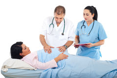 Doctors examine pregnant woman stock photos