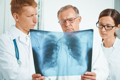 Doctors examine x-ray image in clinic Royalty Free Stock Photography